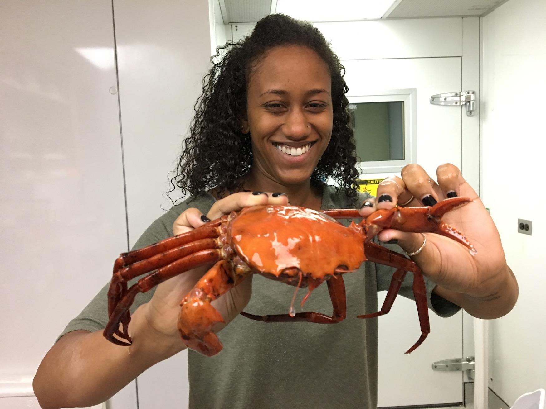 Amanda Lawrence holding a crab