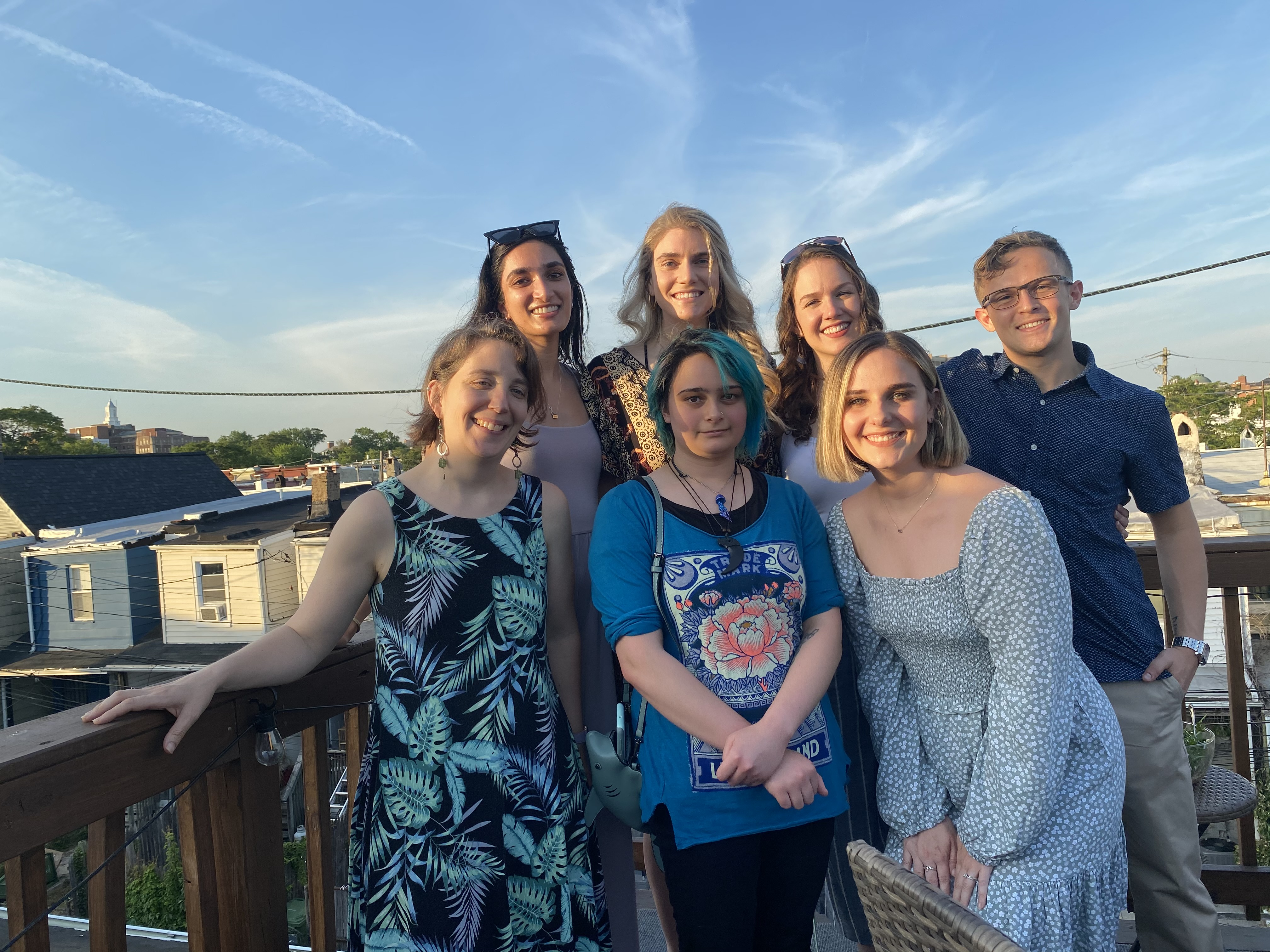 Colleen Burge with six members of her lab on a rooftop