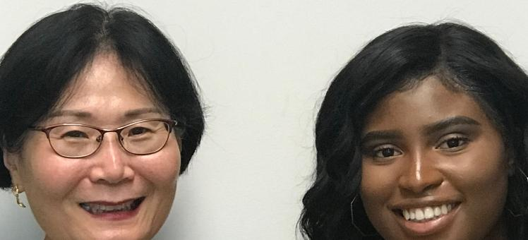 former intern Adjele Wilson poses with her IMET mentor Dr. Sook Chung