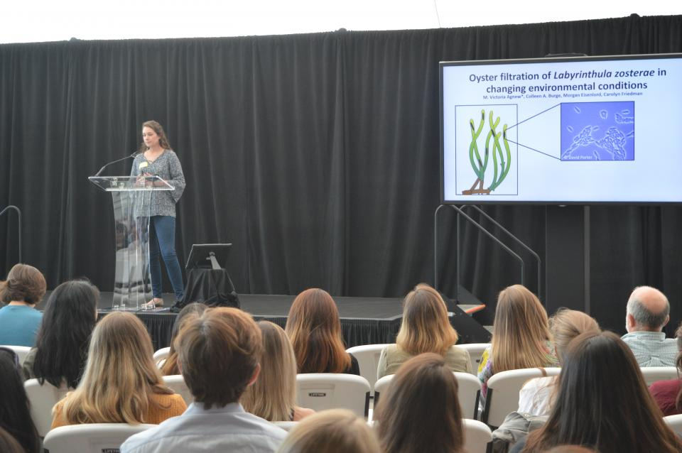 Tori presenting at a conference