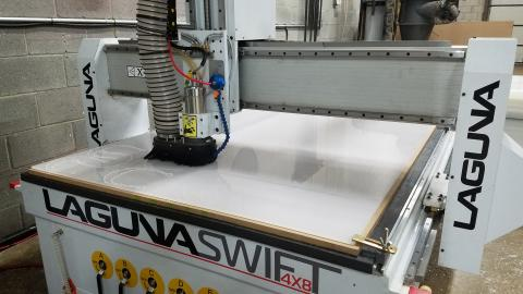 large machine cutting plastic from a sheet