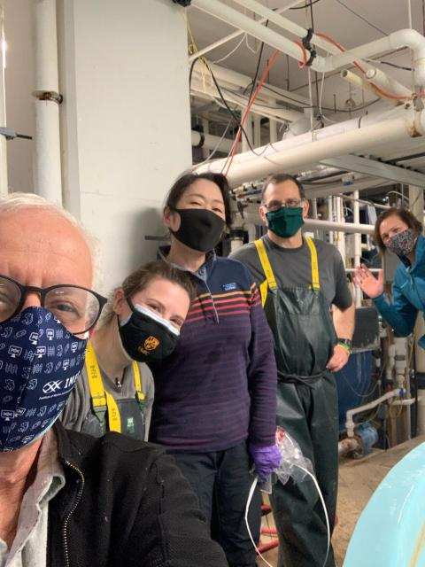 5 people in masks in the Aquaculture Research Center