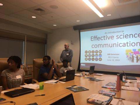 """presentation with slide saying """"Effective science communication"""""""