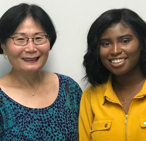 former intern Adjele Wilson poses with her IMET mentor Dr. Sook Chung