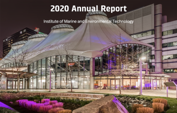 """image of IMET at night with text, """"2020 Annual Report"""""""