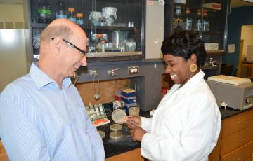Jeanette Davis in the lab with her advisor Russell Hill