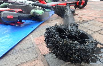 scooter wheel covered in mussels